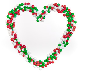 Heart of chocolate candies of Christmas colors