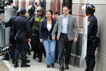 Keiko Fujimori, daughter of former president Alberto Fujimori and leader of the opposition in Peru, accompanied by her husband Mark Vito arrives to court as part of an investigation into money laundering, in Lima