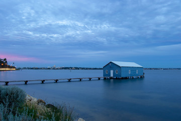 Blue Boat House In Perth at cloudy sunset