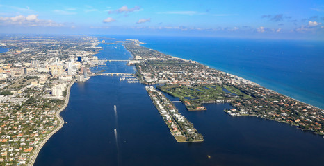 Aerial view of downtown West Palm Beach, Florida, with the Lake Worth Lagoon, and Palm Beach,  in South Florida.