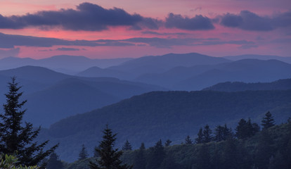 Great Smoky Mountains National Park, North Carolina, USA - July 4, 2018: Mountain layers full of colorful foliage right after sunset in the Great Smoky Mountains