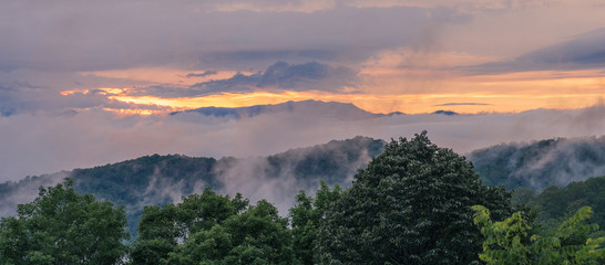 Great Smoky Mountains National Park, North Carolina, USA - June 23, 2018: Clouds between the mountains of the Great Smoky Mountains at sunset