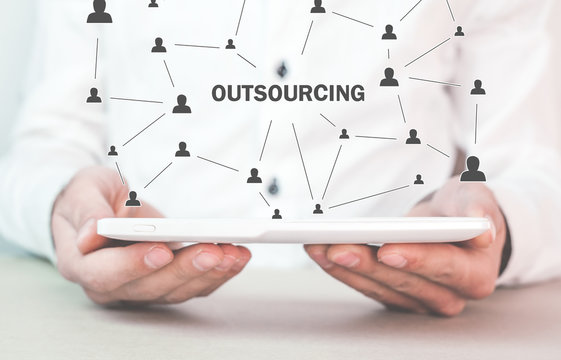 Man holding tablet. Outsourcing, business strategy concept