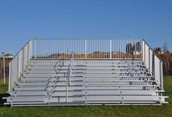 Front view of portable steel bleachers on the field