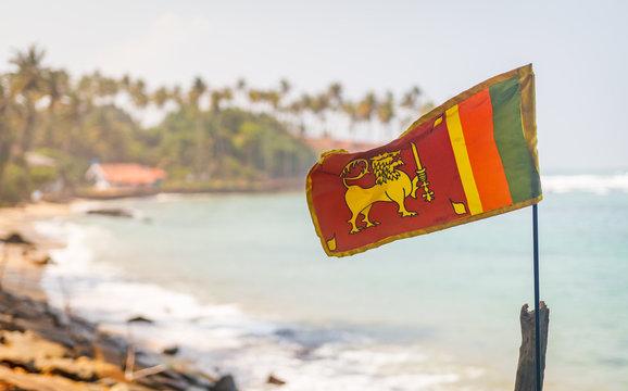 Sri Lanka flag in the Mirissa beach on the background