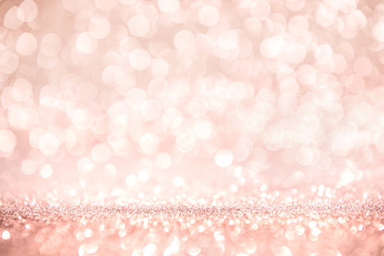 Rose gold and pink glitter, Defocused abstract holidays lights on background.
