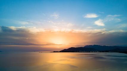 Inspirational beautiful sunset landscape at sea and mountains