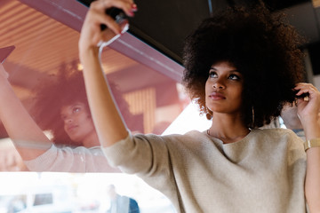 Portrait of attractive afro woman taking selfie portrait