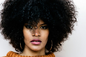 Portrait of attractive afro woman in over the wall