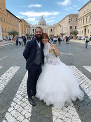 Bride and bridegroom pose for the photo at the Via della Conciliazione leading to the Vatican City in Rome