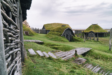 Traditional antique Viking village. Old wooden houses near Vestrahorn mountains on the Stokksnes Peninsula, Hofn, Iceland. Popular tourist attraction.