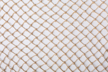 Fishnet on white background. Fishing net. Texture fishnet, seine. Dragnet, drag, trammel, sweep-net