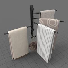 Towels hanging on modern towel rack
