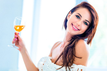 portrait of the beautiful young woman with a drink