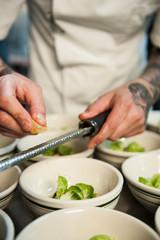Chef preparing brussel sprout dish in restaurant