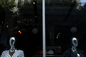 Mannequins are shown in the store front of a fashion shop in downtown Los Angeles