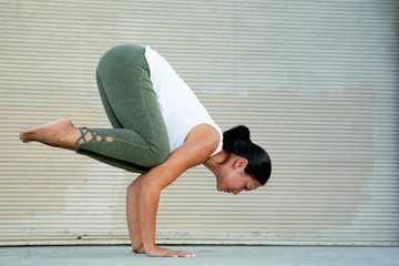 Female Yoga Instructor in Crow Pose