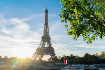 Eiffel Tower famous landmark with shining sun at sunrise, Paris, France