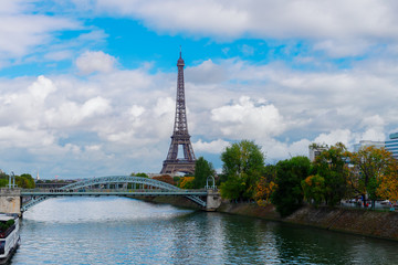 eiffel tour over Seine river with green trees, Paris, France