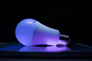 Led lamp shining blue and violet lights, modern techno style
