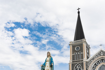 The Blessed Virgin Mary,mother of Jesus on the blue sky, in front of the Roman Catholic Diocese, public place in Chanthaburi, Thailand.