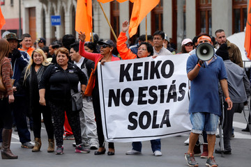 Supporters of Keiko Fujimori, daughter of former president Alberto Fujimori and leader of the opposition in Peru, protest outside the court where she attends a hearing as part of an investigation into money laundering, in Lima