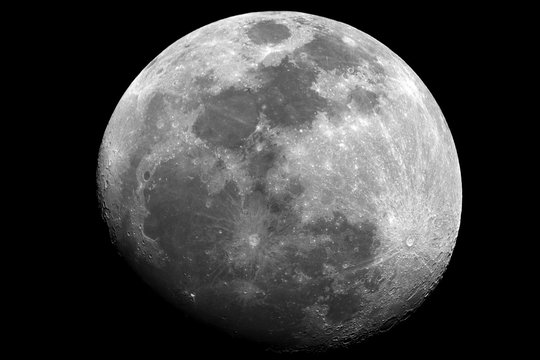 Waxing gibbous Moon phase, in a big Brightless close up, at 1500 mm of focal length, taken with reflector telescope, in black background.
