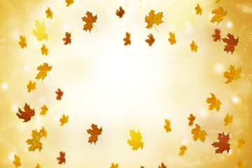 Abstract autumn background with sun rays and flying leaves.