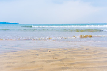 sandy beach with blue waves Sea background