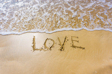 The inscription on the sand love