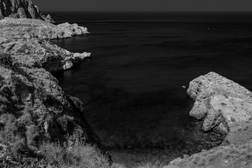 The incredible seascaping view of beach with blue sea in morocco in summer  in Al hoceima in black and white