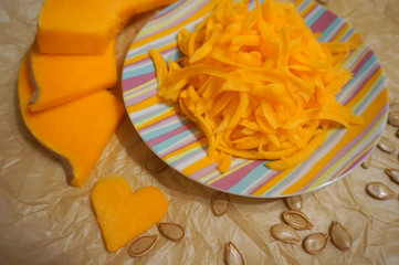 Fresh orange pumpkin, sliced and grated, prepare for cooking. Organic, seasonal, natural and healthy food concept