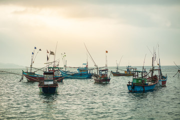 Many fishing boats in the ocean