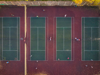 top view play tennis on several courts aerial drone shot f