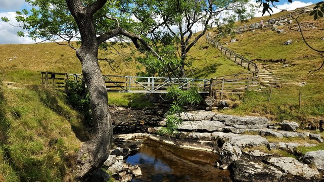 One of the bridges, passing over the river Twiss at Ingleton waterfall trail. North yorkshire - England.