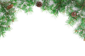 Christmas Frame of Fir tree branch with snow and cone isolated on white background with copy space for your text