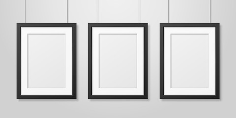 Three Vector Realistic Modern Interior Black Blank Vertical A4 Wooden Poster Picture Frame Set Hanging on the Ropes on White Wall Mock-up. Empty Poster Frames Design Template for Mockup, Presentation