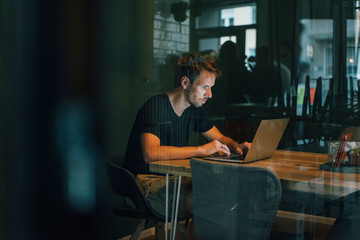 Man sitting in office, working late in his start-up company