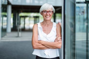 Portrait of smiling senior woman wearing glasses