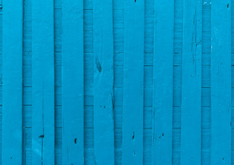 Surface of an empty blue wooden panel for interior design and exterior decoration.