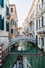Italy, Venice, Canal with bridge and houses