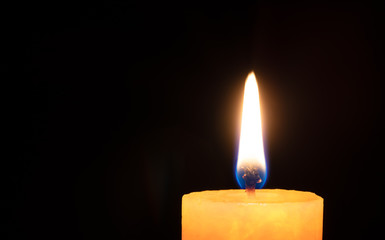 Flame and candle top in black background