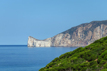 Scenic panoramic view of the coast line and Mediterranean Sea at southwest Sardinia, Italy