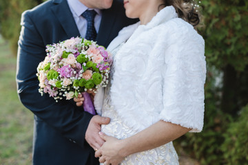 bride holds a bouquet, the bride's bouquet, bride and groom, wedding day