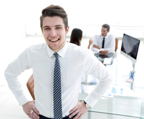 successful businessman on background of office.