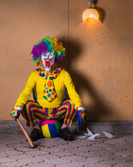 evil clown with a bat