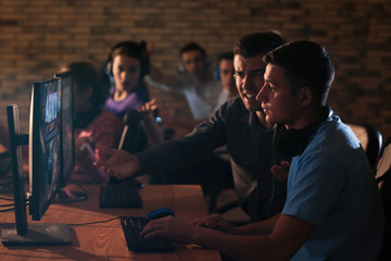 Young people playing video games at tournament
