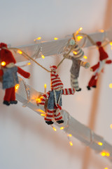 Christmas toys with garlands on the wooden garden