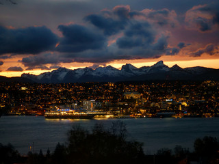 Tromso by nighfall with Hurtigruten ship docked