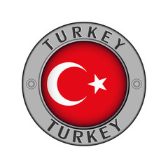 A medallion with the name of the country Turkey round flag